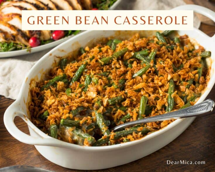 keto green bean casserole in white baking dish with serving spoon inside