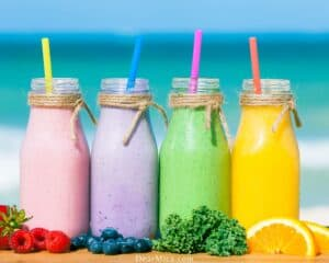Assortment of low carb smoothies with an ocean background.